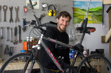 Alex fixes a bike at Long Alley Bicycles, Halifax