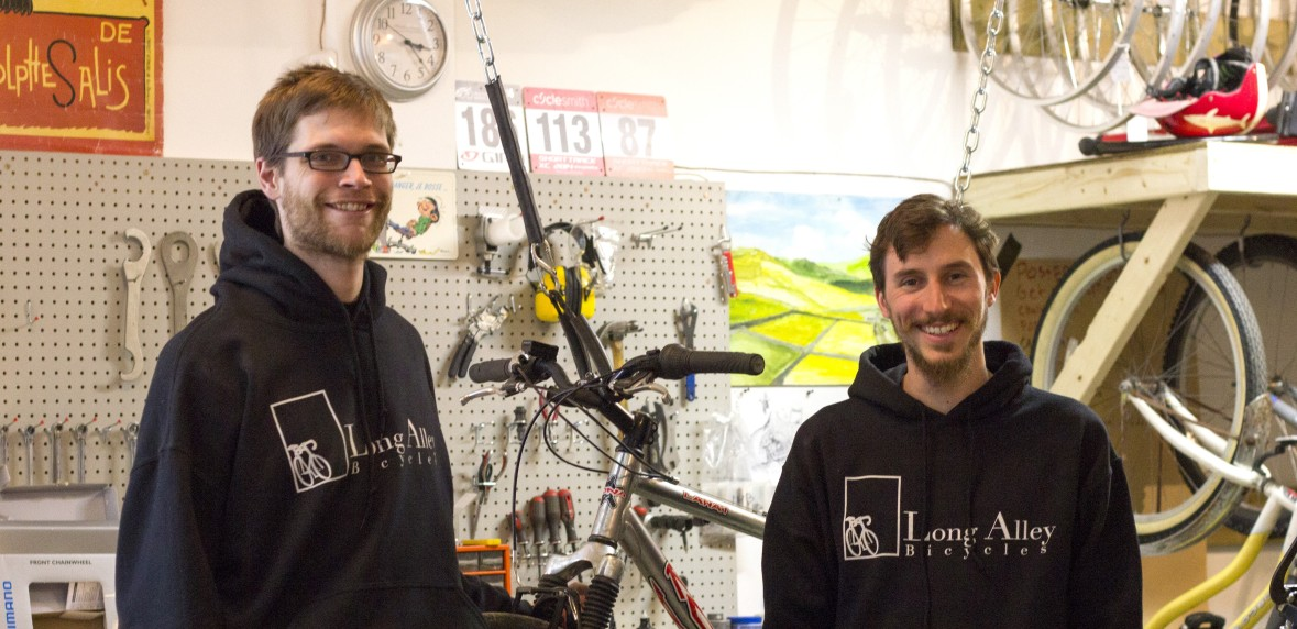 Alex and Paul take a break from fixing bikes at Long Alley Bike Shop