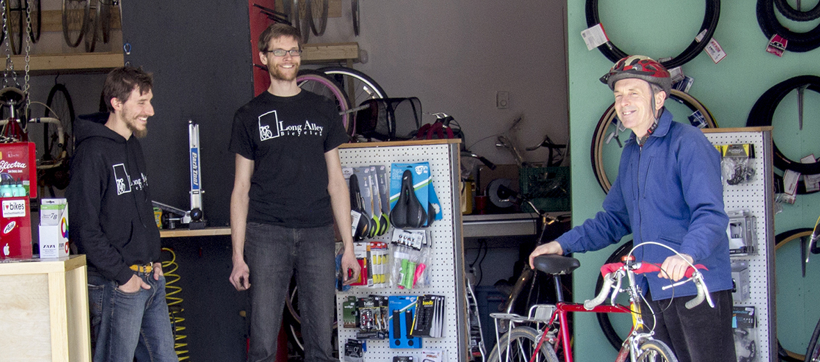 Alex and Paul help a customer at Long Alley Bicycles, Halifax